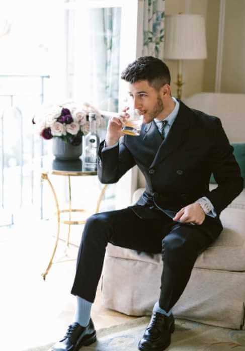 Nick Jonas at drinks Image