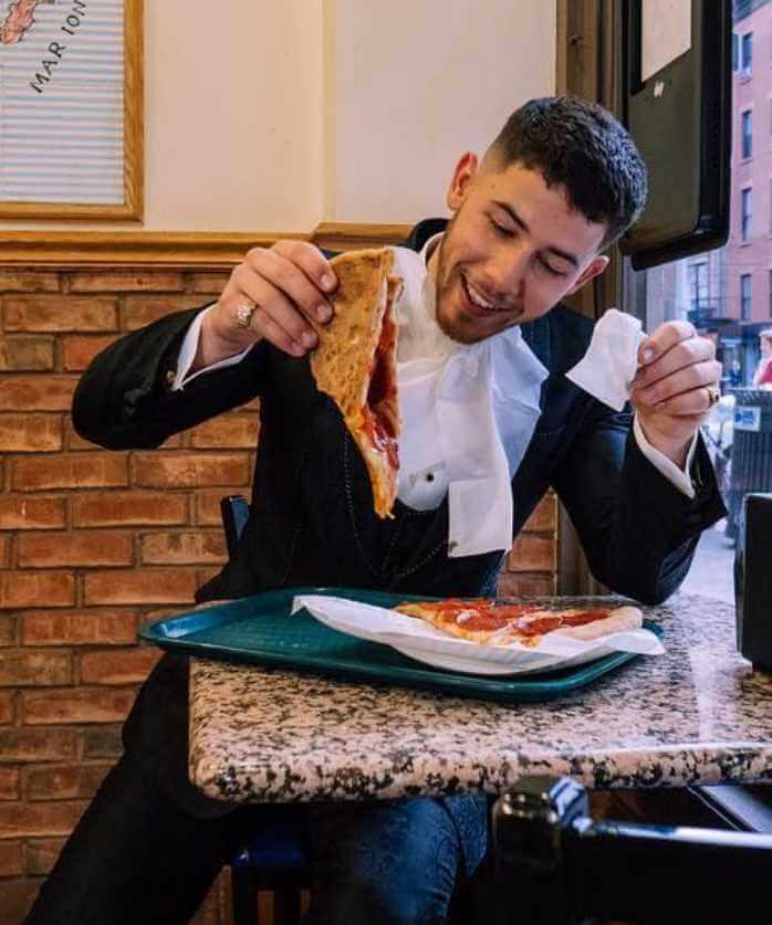Nick Jonas with foods Image