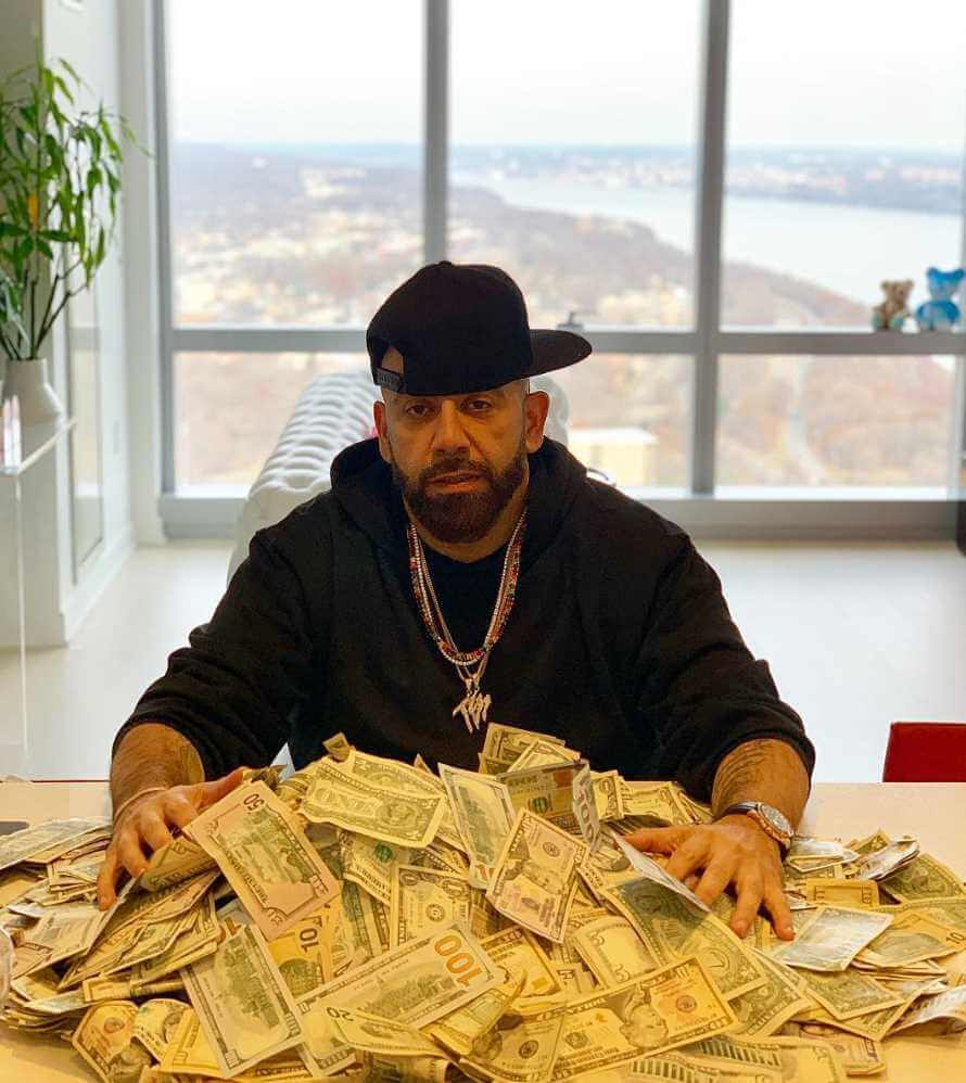 Mark Farese with money Images