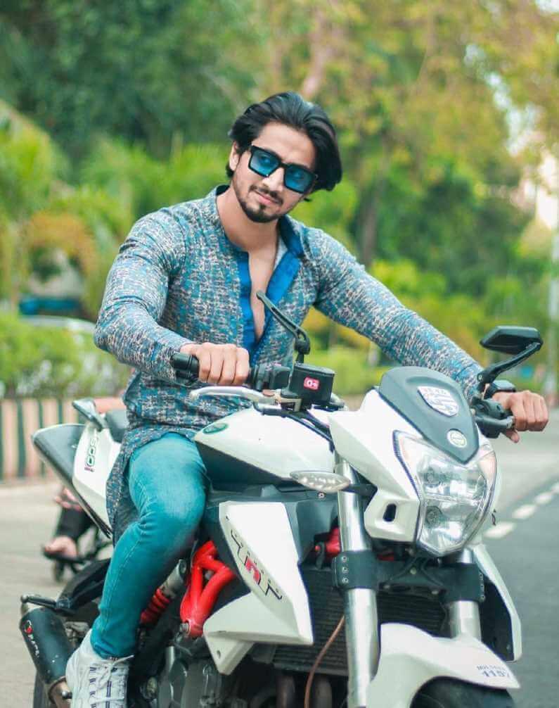 Mr. Faisu with Bike Image