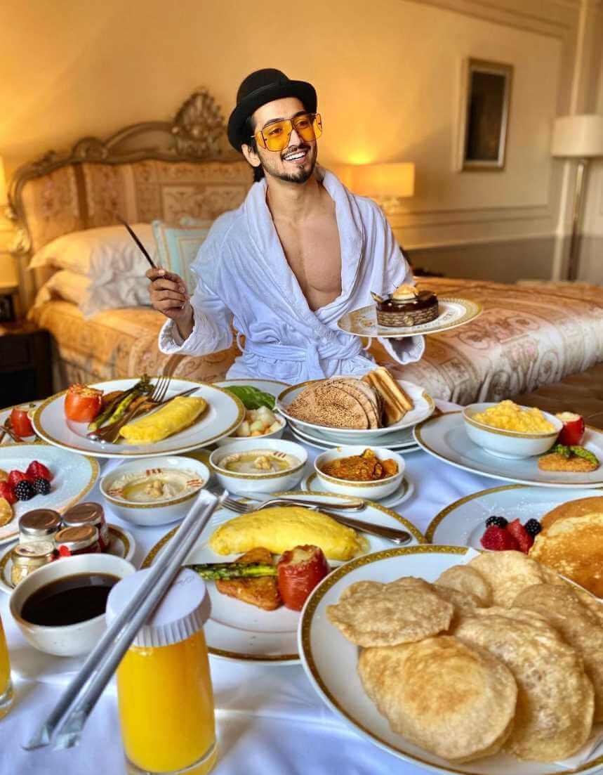 Mr. Faisu with foods Image