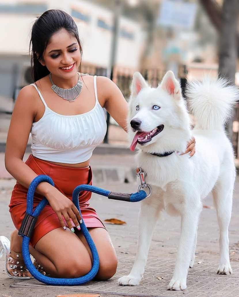 Nisha Guragain with her Dog Image
